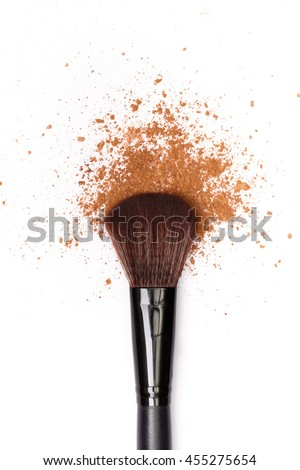 close up of a make up powder and a brush. makeup brush with powder foundation isolated on white #455275654