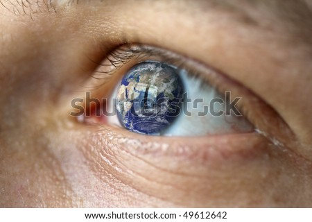Close-Up of a male face with the earth in the eye (asia view).