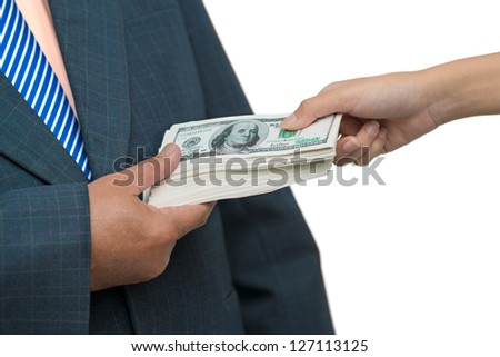 Close up of a male hand taking bribe