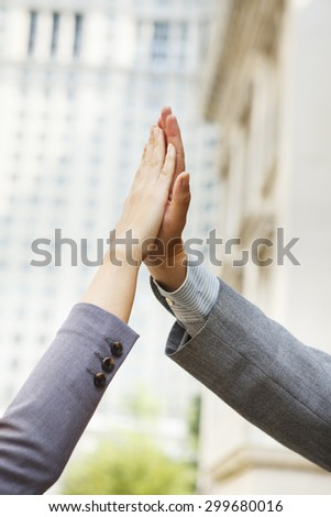 Close-up of a man and woman\'s hands doing a  \