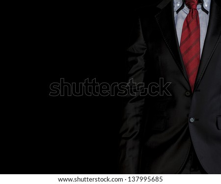 close up of a man black suite and tie