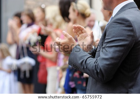 Close-up of a man clapping his hands