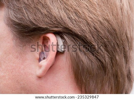Close-up of a man ear with a high-tech digital hearing aid