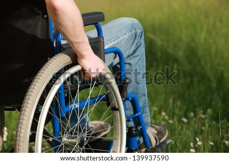 Close up of a man in a wheelchair in the park