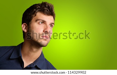Close-up Of A Man Looking Away On Green Background