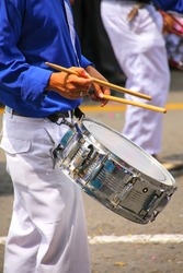 Close up of a man playing drum during Festival of the Virgin de la Candelaria in Lima, Peru. The core of the festival is dancing and music performed by different dance schools.