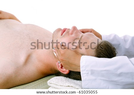 Close up of a man receiving facial massage from a woman