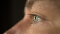 Close up of a man's blue eye