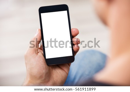 Close-up Of A Man's Hand Holding Cell Phone With Blank Screen