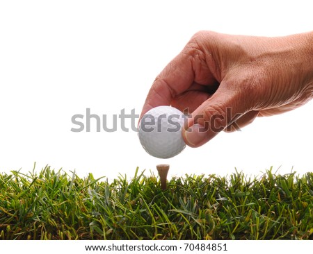 Close up of a man's hand placing a golf ball on a tee, Horizontal format isolated over white