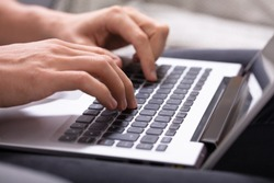 Close-up Of A Man's Hand Using Laptop