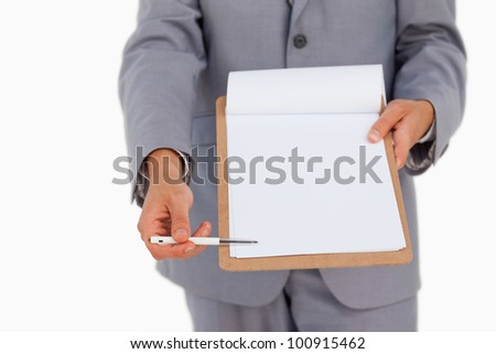 Close-up of a man showing a file against white background