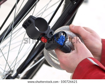 Close up of a man tying his bike