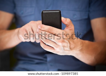 Close up of a man using mobile smart phone