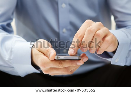Close up of a man using mobile smart phone #89533552