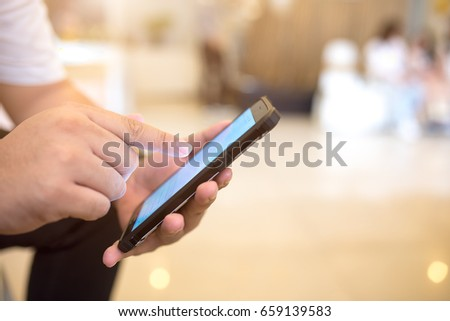 Close up of a man using smart phone for business  #659139583