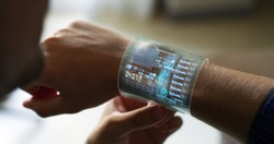 Close up of a man with futuristic  armband liquid crystals smart watch  with the latest advanced augmented reality holographic technology.