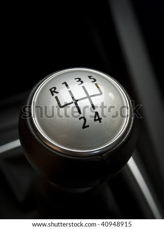 close up of a manual car gear shift. 6 speed manual.