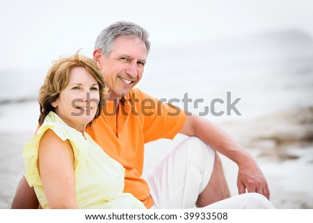 Close-up of a mature couple relaxing on the beach