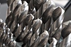 Close up of a metal drill bit set.For hard metals such as stainless steel, it's best to use drill bits made of chrome vanadium, cobalt or titanium carbide.