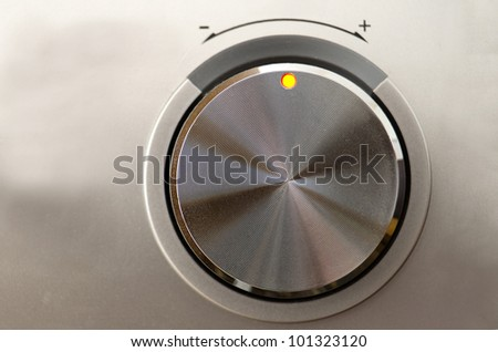 Close up of a metallic volume knob