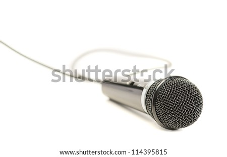 Close-up Of A Microphone Isolated On White Background
