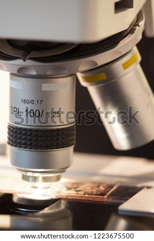 close-up of a microscope objektive with object slide  #1223675500