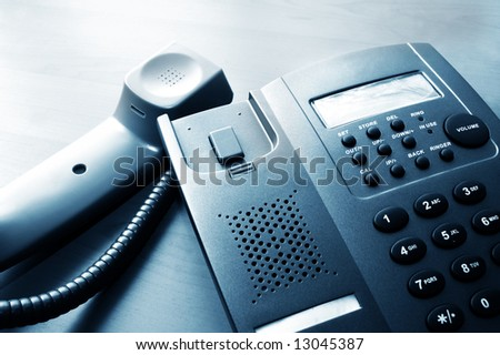 close-up of a modern corporate office dial telephone