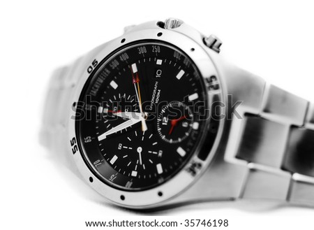 close up of a modern mens watch isolated againts white