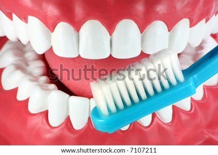 Close-up of a mouth and toothbrush