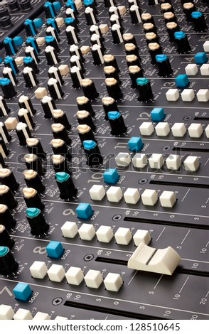 Close up of a multi-channel mixing desk.