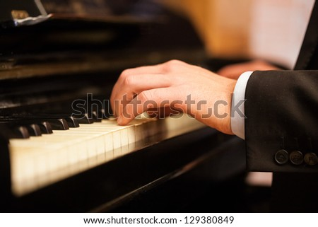 Close up of a musician playing a piano keyboard #129380849