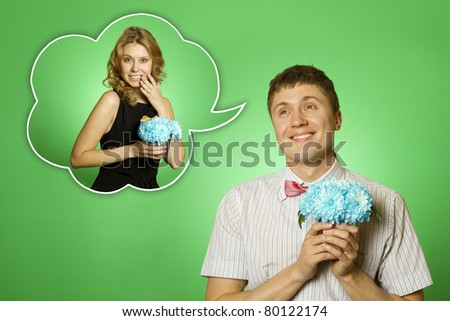 Close-up of a nerd shirt bow tie with a bouquet of flowers is dreaming about the girl. Air thought they schaslivaya girl with flowers