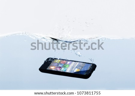 Close-up Of A New Black Mobile Phone Submerged In Water #1073811755
