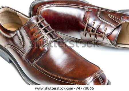 Close up of a new pair of brown leather dress shoes