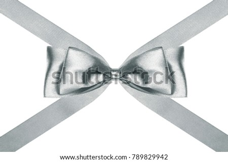 close up of a nice silver satin ribbon bow with crosswise ribbons on white background #789829942