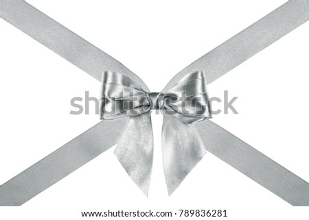 close up of a nice silver silk ribbon bow with crosswise ribbons on white background #789836281