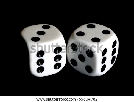 Close up of a pair of dice with seven and eleven showing.
