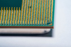 Close-up of a part of a microprocessor in soft focus under high magnification. Details of a computer component under a microscope on a light background