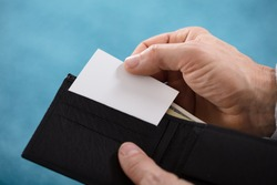 Close-up Of A Person's Hand Removing Blank White Card From Wallet
