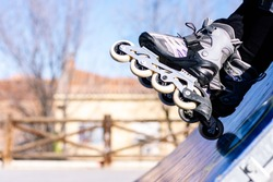 Close up of a person's legs with the roller skates on. Urban skating concept