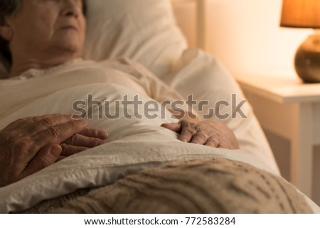 Close-up of a person supporting a sick, bedridden family member at home Foto stock ©