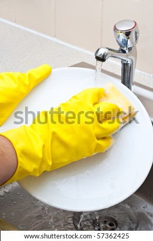 close up of a person washing a plate