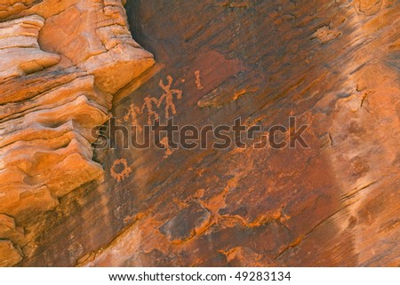Close-up of a petroglyph of human figures etched on rock wall, Valley of Fire State Park, Nevada, USA