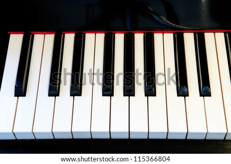Close-up of a piano keyboard with white keys - stock photo
