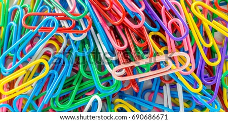 Close up of  a Pile of Colorful Paperclips