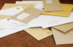 Close up of a pile of mail on doormat