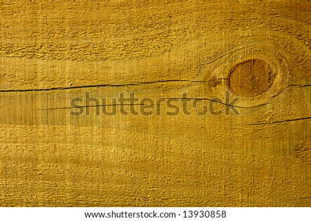 Close-up of a pine plank with a knot in it.