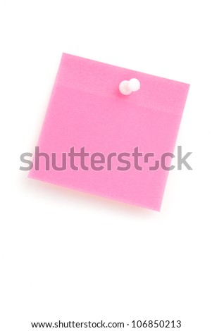 Close up of a pink adhesive note with pushpin against a white background