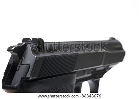 close-up of  a pistol, aiming at the goal